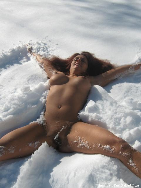 Naked woman shoveling snow naked